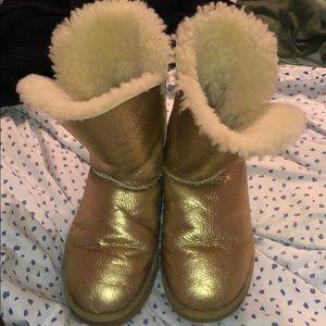 Gold short bailey button Ugg boots.